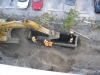 Placing gravel between trench box for infiltration drainage pipe over geotex fabric